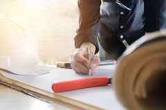 Close up hand of young man working on his plane project at site. Construction work Stock Image