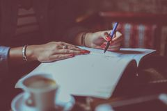 Close up of hand young student girl writing. royalty free stock images