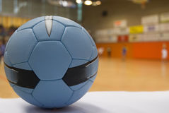 Close up of a handball ball. Players out of focus at the bakckground Stock Photos