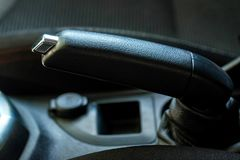 Manual brake in interior of modern car close stock images