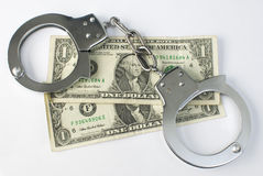 Close-up handcuffs and money Royalty Free Stock Photos