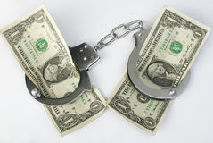 Close-up handcuffs and money Stock Photography