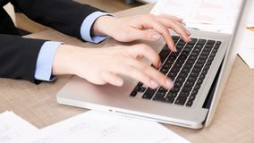 Woman hands typing on laptop keyboard. Close up handheld footage of woman hands typing on laptop keyboard stock video
