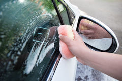 Close up of handle car washing with sponge and soap Royalty Free Stock Images