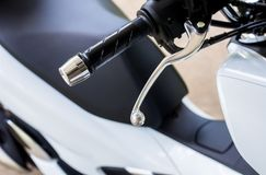 Close up of handlebars and front break on new modern motorcycle. Close up of handlebars and front break on motorcycle,Selective focus Stock Image