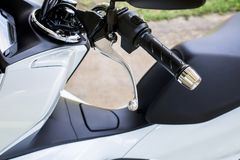 Close up of handlebars and front break on motorcycle. Close up of handlebars and front break on new motorcycle Stock Photos
