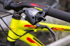 Close-up of handlebars with Shimano brake lever. Tambov, Russian Federation - May 07, 2017 Close-up of handlebars with Shimano brake lever royalty free stock photography