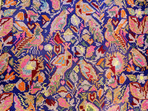 Close up of handmade embroidered fabric with motifs of birds royalty free stock photography