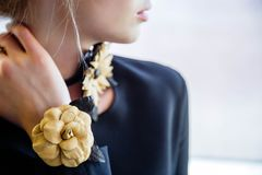 Close-up of handmade leather jewelry on a girl. royalty free stock photography