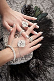 Close up of hands with accessory. Hand over woman bag filled with jewelery Stock Photos