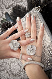 Close up of hands with accessory. Hand over woman bag filled with jewelery Stock Image
