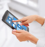 Close up of hands with applications on tablet pc Stock Image
