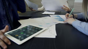 Close up on hands of architect group, discussing project with tablet. stock video footage