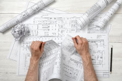 Close-up hands of architect tearing a bad drawing. Royalty Free Stock Image