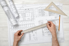 Close-up hands of architect while working process with centimeter ruler. Stock Photos