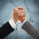 Close up of hands armwrestling over concrete wall Royalty Free Stock Photography