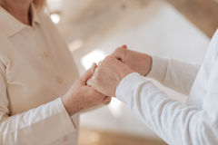 Close up of hands being held together Stock Image