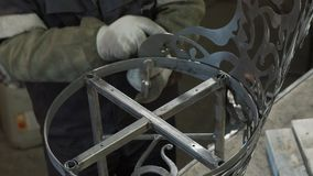 Close-up - Hands Of A Blacksmith Weld Elements To Their Forged Product