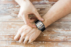 Close up of hands with blog on smart watch screen Stock Images
