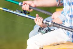 Close-up of hands of a boy with a fishing rod Stock Images