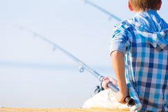 Close-up of hands of a boy with a fishing rod Stock Image