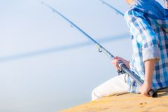 Close-up of hands of a boy with a fishing rod Stock Photography