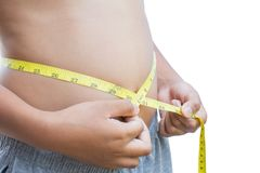 Close up hands boy measuring tape on abdominal surface Royalty Free Stock Photos