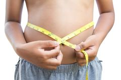 Close up hands boy measuring tape on abdominal surface Royalty Free Stock Image