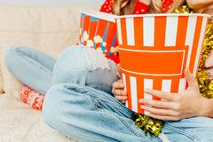 Close-up, in the hands of a bucket of popcorn, watching a movie stock photos