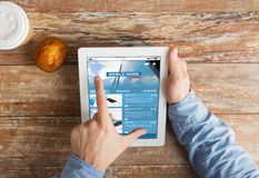 Close up of hands with business news on tablet pc Royalty Free Stock Photo
