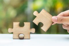 Close up of hands business women connecting jigsaw puzzle, Teamwork workplace success and strategy concept royalty free stock photography
