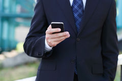Close up of the hands of the businessman with a mobile phone Royalty Free Stock Images