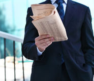 Close up of the hands of the businessman with a newspaper Stock Photography