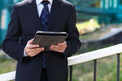 Close up of the hands of the businessman with a tablet PC Stock Photo