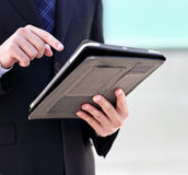 Close up of the hands of the businessman with a tablet PC Stock Images