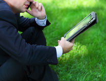 Close up of the hands of the businessman with a tablet PC Royalty Free Stock Image