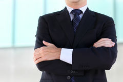 Close up of the hands of the businessman wearing blue suit Royalty Free Stock Image