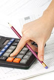 Close-up of hands with a calculator Royalty Free Stock Photo