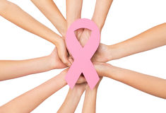 Close up of hands with cancer awareness symbol Royalty Free Stock Photos