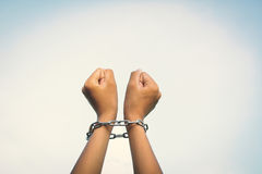 Close up hands in chains. Concept lack of freedom Royalty Free Stock Photos
