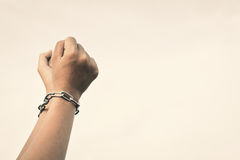 Close up hands in chains. Concept lack of freedom Royalty Free Stock Photo