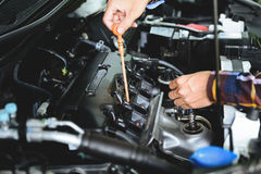 Close up hands checking lube oil level of car engine from deep-s Royalty Free Stock Photos