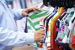 Close-up hands choosing clothing Royalty Free Stock Image