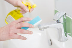 Close Up Of Hands Cleaning Bathroom Sink Stock Photo