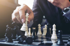 Close up of hands confident businessman colleagues playing chess Royalty Free Stock Photo