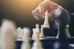 Close up of hands confident businessman colleagues playing chess Royalty Free Stock Photography