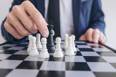Close up of hands confident businessman playing chess game to de Stock Photography