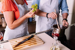 Close up of hands cooking a dinner Stock Image