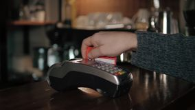 Close up of hands with credit card reader at modern cafe Royalty Free Stock Image