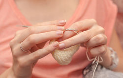 Close up of hands crocheting with wool. Selective focus Stock Image
